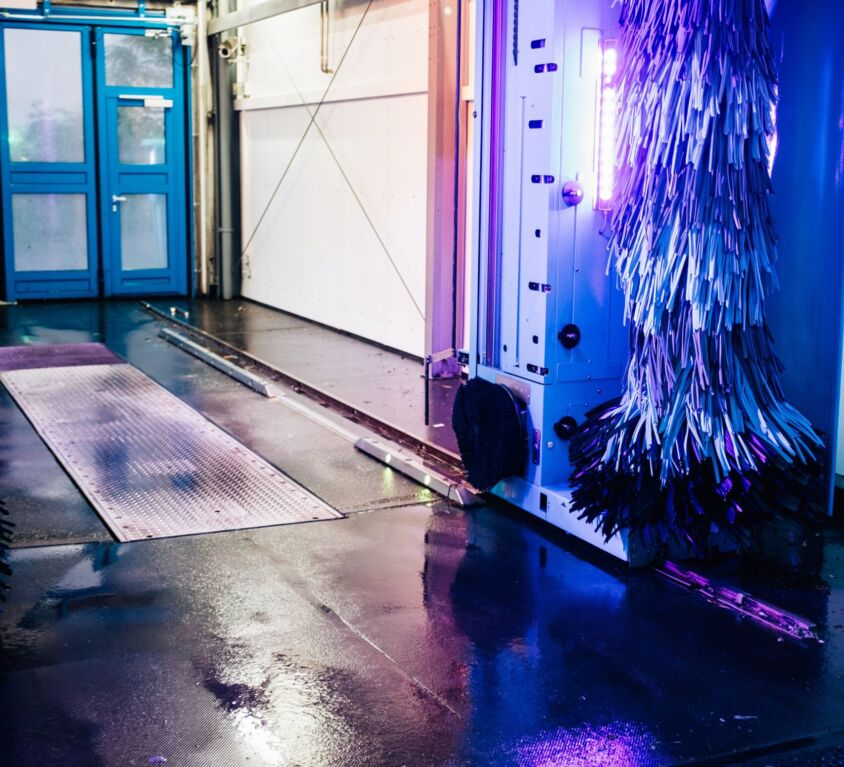 purple-and-blue-light-on-the-inside-of-a-car-wash